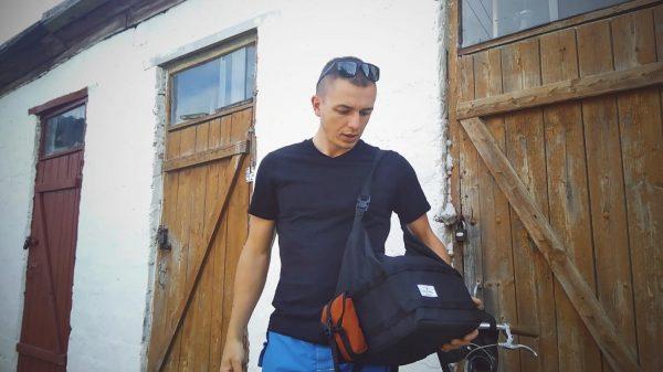 men with shoulder bag for front rack