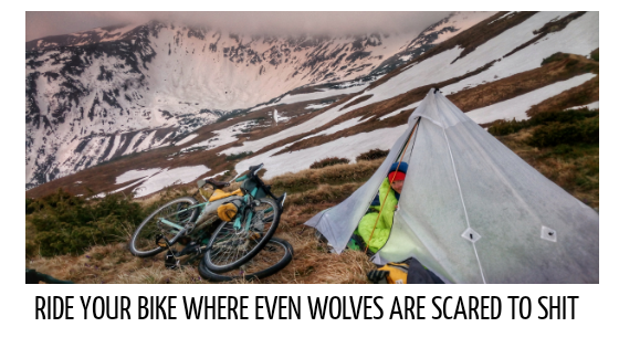 lightweight tent on the top of the mountain bicycle frame bag girl adventure